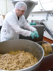 Field Roast employee mixes ingredients to make vegan sausages.
