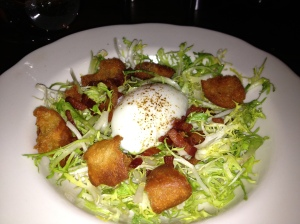The lyonnaise salad has a perfectly cooked egg via sous vide as the centerpiece. Photo by Christine Willmsen