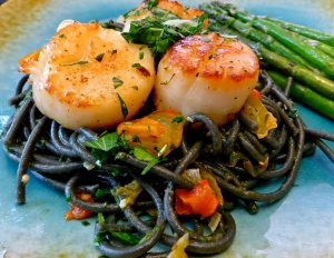 Black squid ink pasta is the perfect color contrast to the seared scallops. Photo by Christine Willmsen