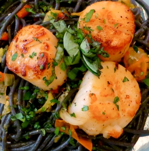 Pat dry scallops, season and sear for 2 minutes per side. Photo by Christine Willmsen