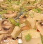 Spread parsnips, leeks and mushrooms on foil-covered baking sheet.
