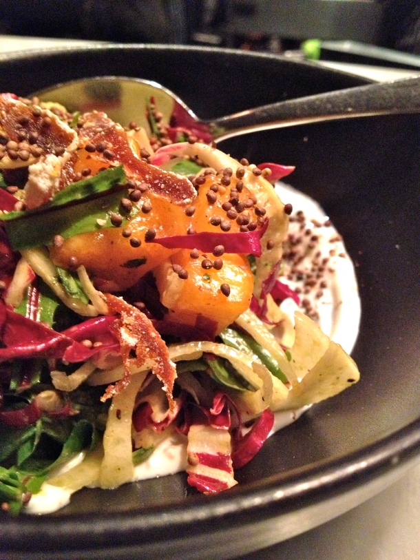 The persimmon salad is full of surprises as a starter. Photo by Christine Willmsen