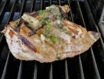 For side vegetables, add a sweet potato and half onion to the grill while cooking the hen. Photo by Christine Willmsen